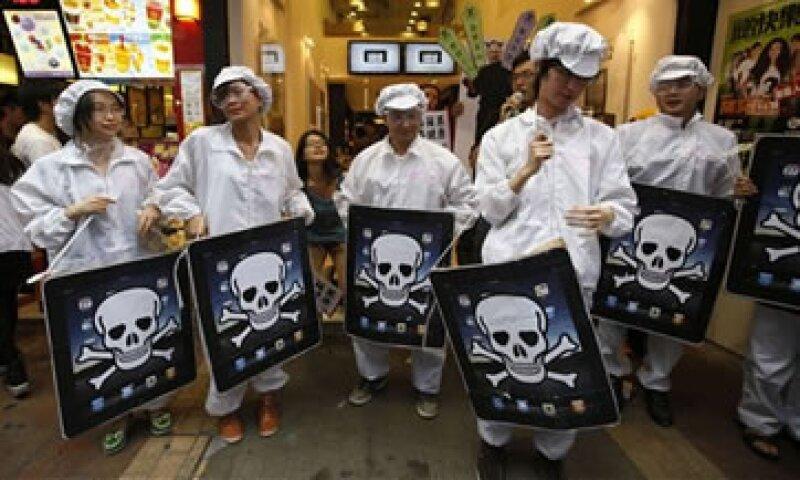 La granb mayoría de los 1.3 millones de empleados de Foxconn participan en el ensamblado de productos de Apple. (Foto: AP)