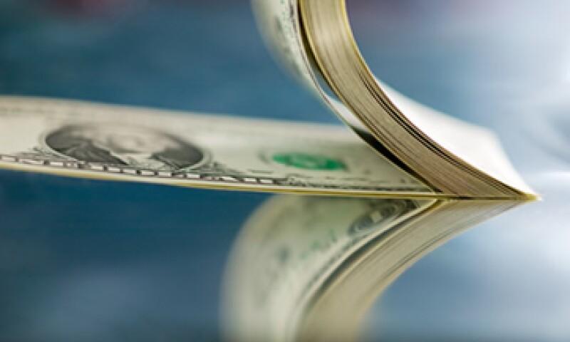 Banxico fijó el tipo de cambio en 12.7981 pesos para solventar obligaciones denominadas en moneda extranjera.  (Foto: Getty Images)
