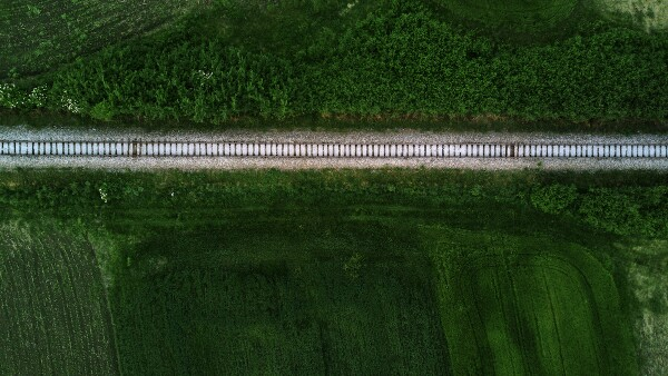 Aerial view of railway track through countryside, drone pov