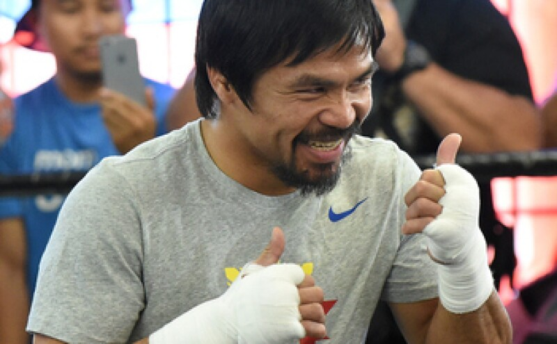 La pelea entre Pacquiao y Mayweather está valuada en 300 mdd. (Foto: Getty Images )