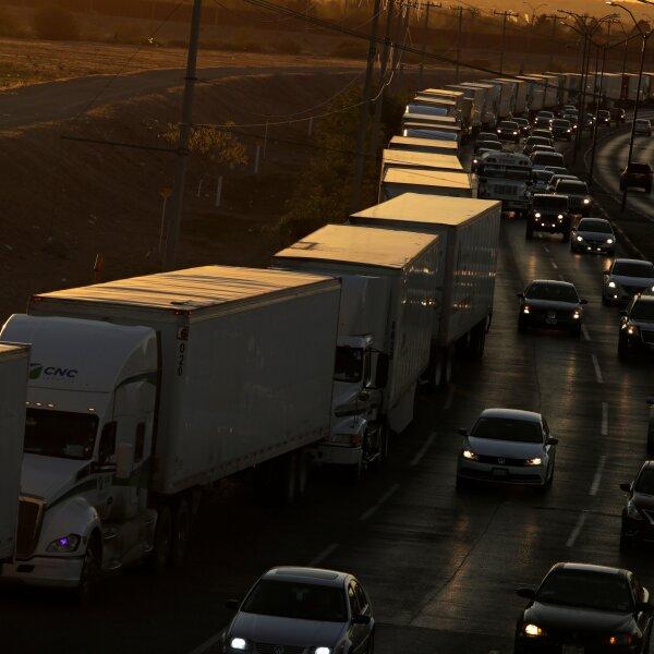 Trucks wait in a long queue for border customs control to cross into U.S., at the Cordova-Americas border crossing bridge in Ciudad Juarez