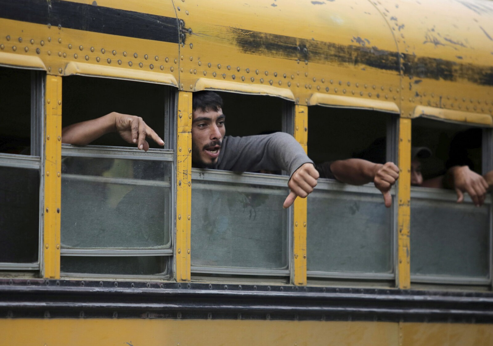 Honduran migrants are seen after arriving on a  bus with people of a caravan after being deported from Mexico
