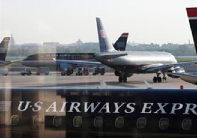 US Airways dijo estar abierta a negociar su posible fusión con otra aerolínea. (Foto: AP)