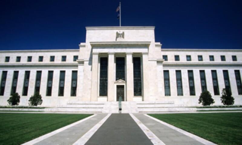 La Fed compra actualmente 85,000 mdd en bonos para alentar la economía. (Foto: Getty Images)