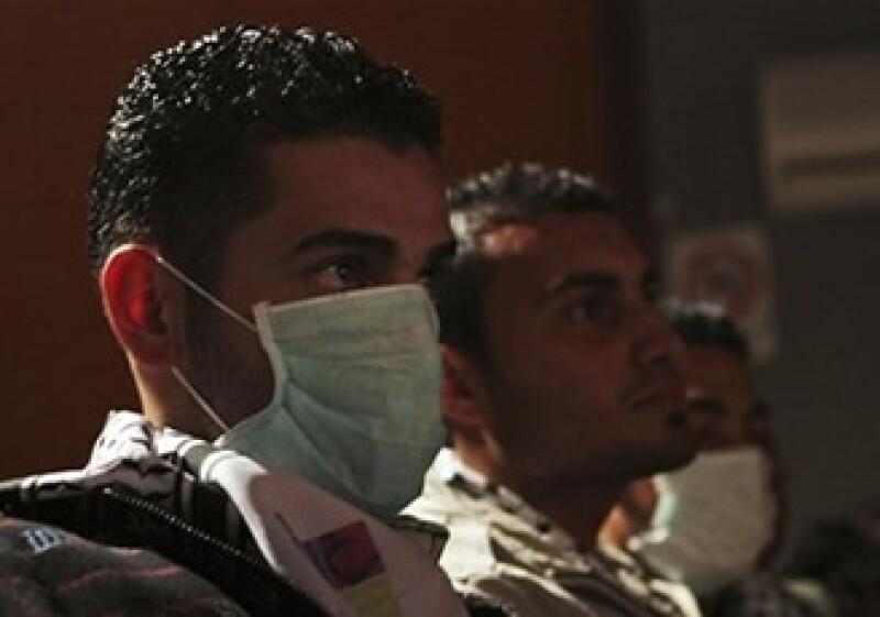 La mayoría de las empresas a nivel mundial se preparan para un rebrote del virus de la influenza humana (Foto: AP)