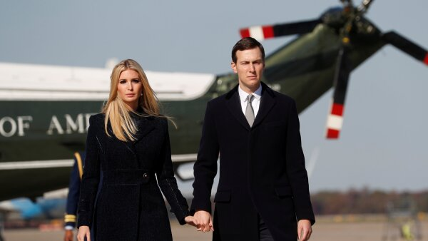 White House advisors Ivanka Trump and Jared Kushner walk to Air Force One on route to Pittsburgh with president in Maryland