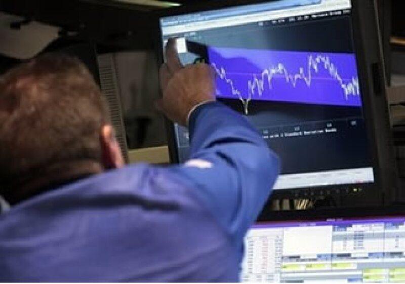 Las acciones de Wall Street presentan un alza. (Foto: AP)