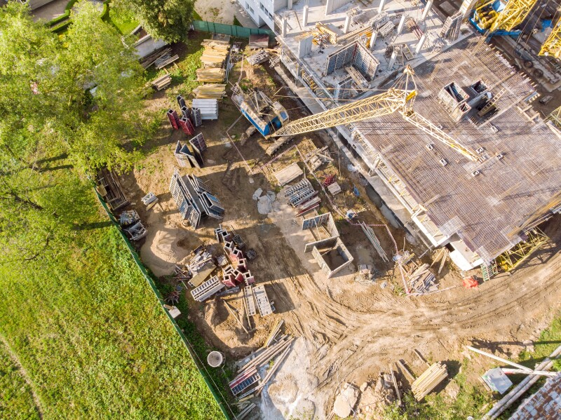 birds eye view of apartment building construction site in progress