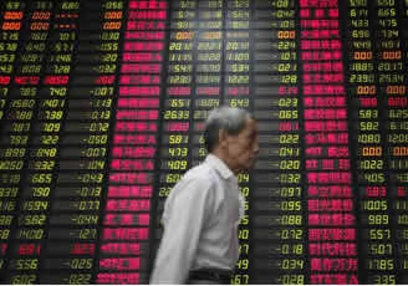 Los mercados tuvieron tranquilidad tras un reporte que mostró una contracción menor a la esperada en la economía estadounidense entre abril y junio. (Foto: AP)