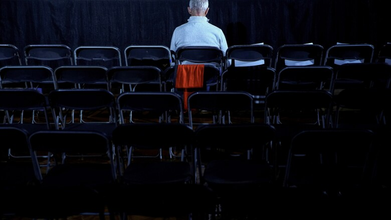 A man waits before the rally for Democratic presidential candidate Pete Buttigieg at Drake University in Des Moines in Des Moines, Iowa, U.S.,