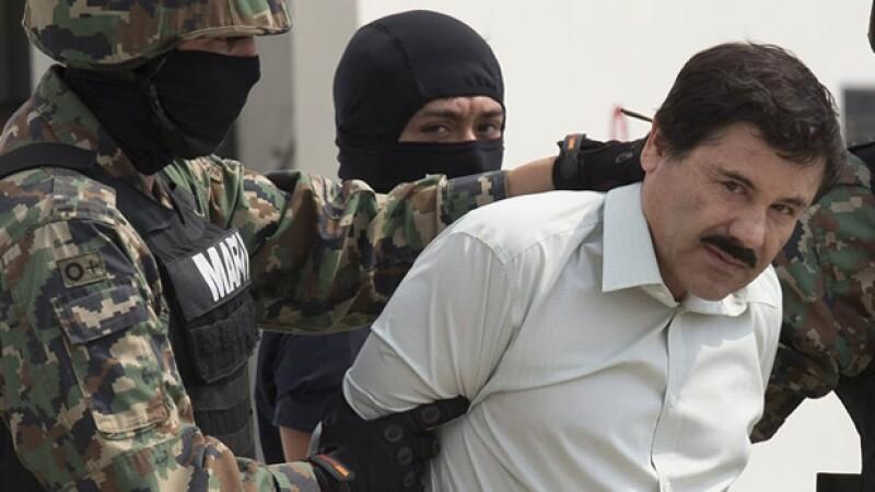 El chapo en su captura el 22 de Febrero del 2014.