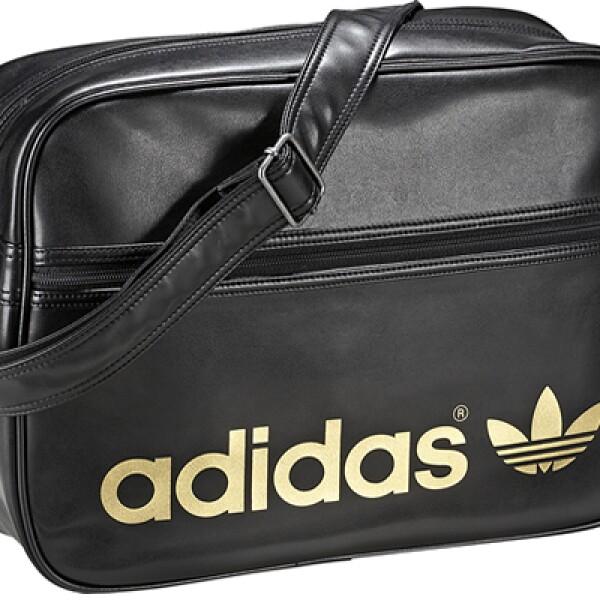 La Airline Bag negra con el logotipo en dorado cuenta con correas ajustables. Ideal para llevar al gimnasio.