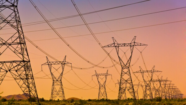 Electric Power Lines and Transmission Tower, Electric grid at sunset