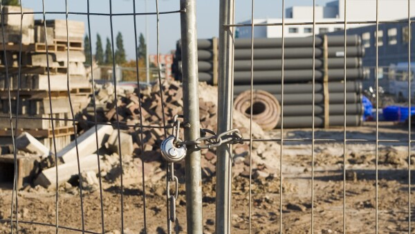 Locked fence at building site