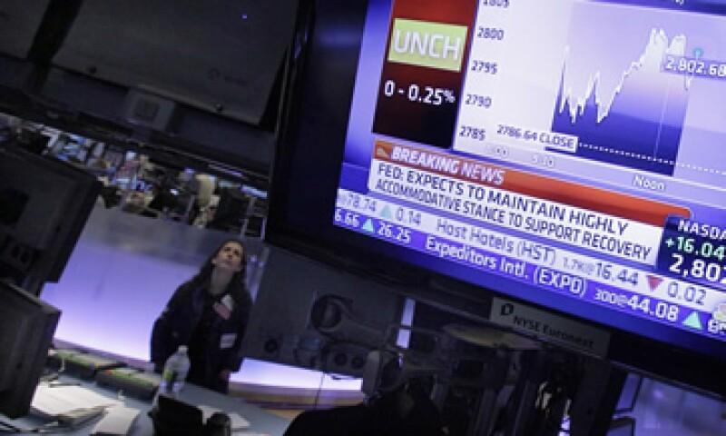 El Nasdaq amplió sus ganancias, tras el impulso previo que le dio las acciones de Apple. (Foto: AP)