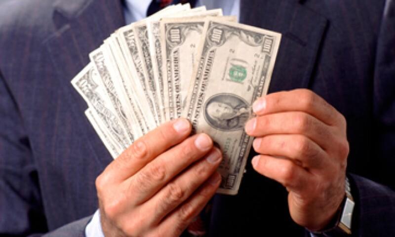 El tipo de cambio podría fluctuar este miércoles entre 12.36 y 12.49 pesos por dólar, estima Banco Base. (Foto: Getty Images)