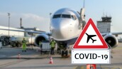 Airplane at the airport warning sign coronavirus