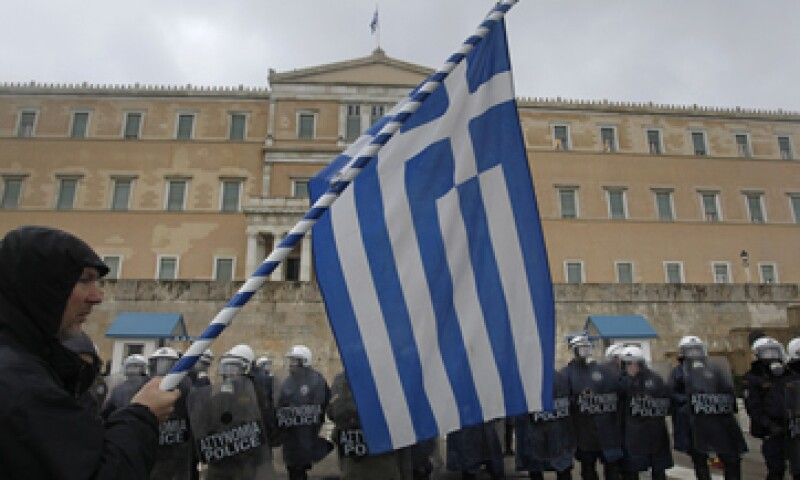 Los inversores privados han aceptado asumir una pérdida real del 75% sobre sus títulos de Grecia. (Foto: AP)