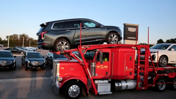 A car hauler delivers two 2020 Cadillac XT6 vehicles to La Fontaine Cadillac dealership in Highland, Michigan,