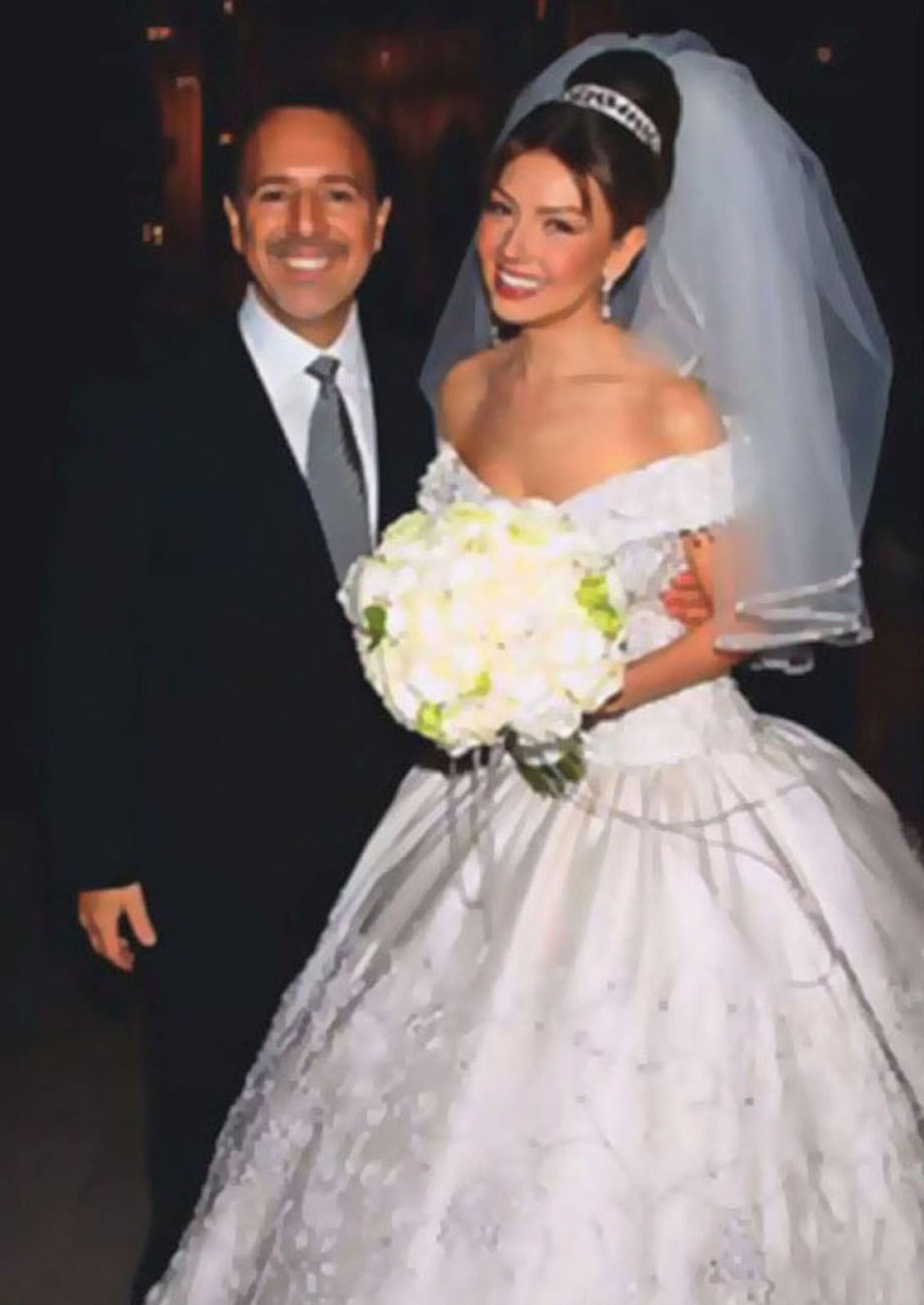 Tommy Mottola y Thalía.