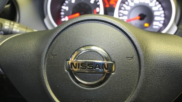Nissan logo on a car steering wheel