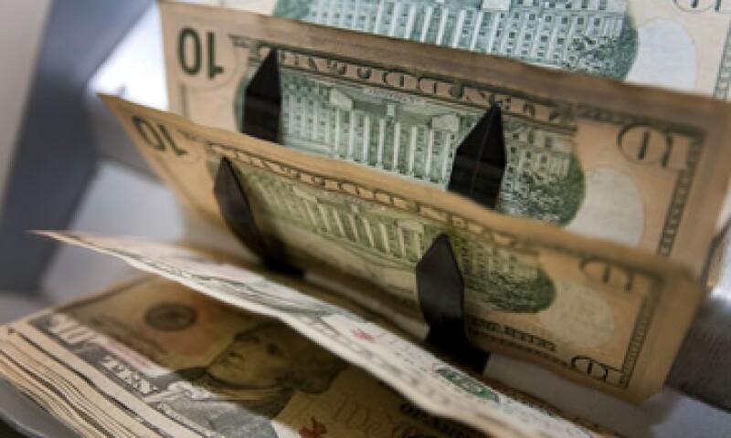 Banco Base estima que este martes, el tipo de cambio podría cotizar entre 12.63 y 12.72 pesos por dólar. (Foto: Getty Images)