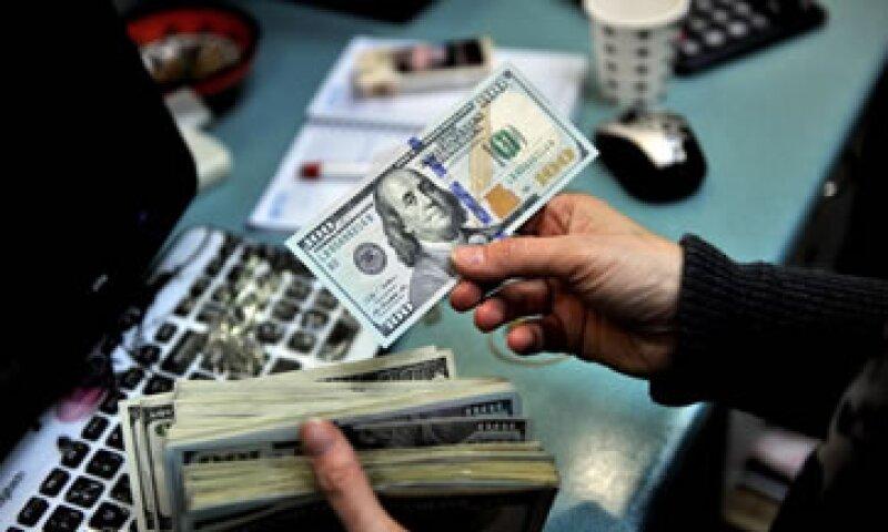 El tipo de cambio para solventar operaciones en moneda extranjera pagaderas en el país es de 13.31 pesos. (Foto: Getty Images)