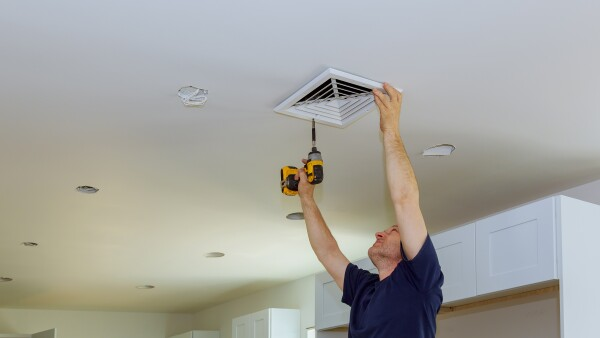 Indoor installing central air conditioning vents on the wall