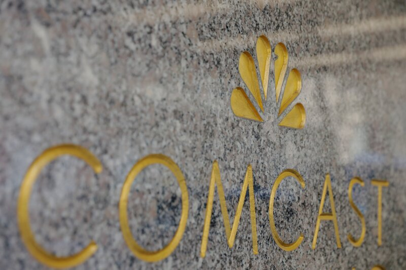 FILE PHOTO: The NBC and Comcast logos are displayed on 30 Rockefeller Plaza in midtown Manhattan in New York