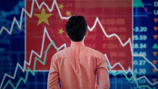 Businessman with a stock market of china