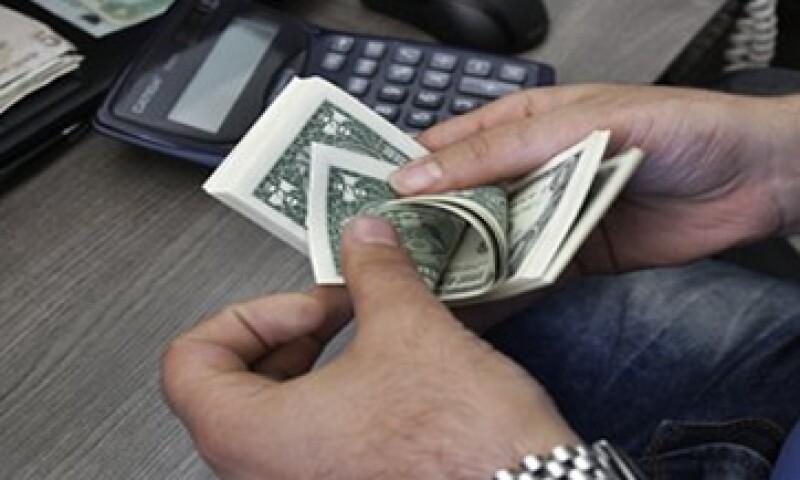El tipo de cambio es de 13.0372 pesos para solventar obligaciones denominadas en moneda extranjera. (Foto: Getty Images)