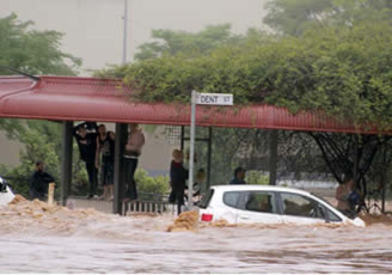 La primer ministra Julia Gillard dijo que las inundaciones cubrieron miles de casas, cerraron minas de carbón, arruinaron cosechas y destruyeron caminos. (Foto: AP)