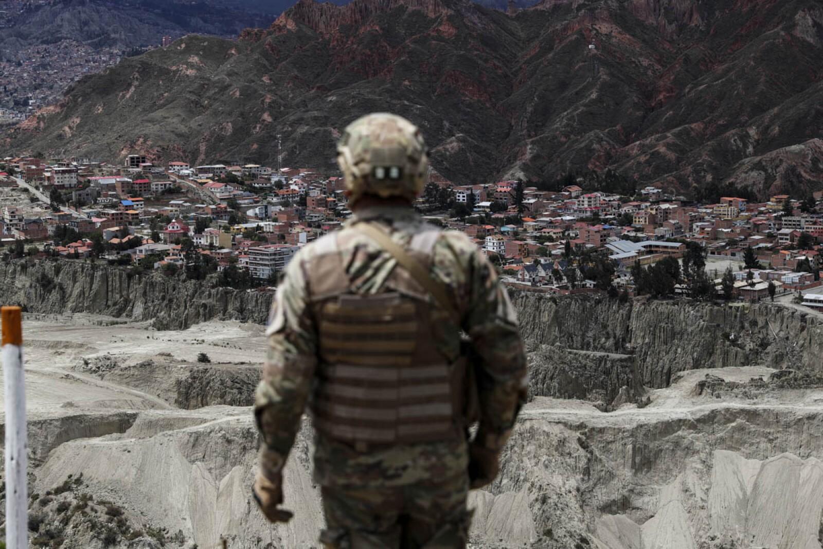 Military members patrol the streets in La Paz