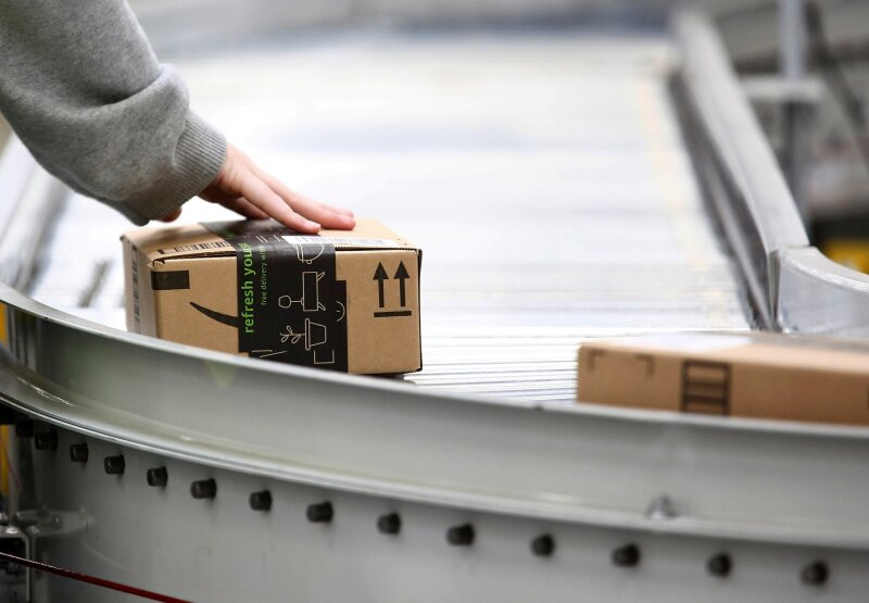 Employees work at the Amazon fulfillment center in Kent