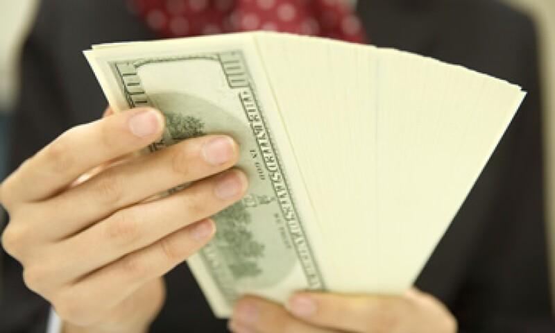 Banco Base estima que el tipo de cambio fluctuará entre 12.48 y 12.59 pesos por dólar. (Foto: Getty Images)