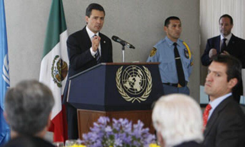 El presidente Peña Nieto reiteró que su Gobierno será facilitador de inversiones y respetuoso de la propiedad privada. (Foto: AP)