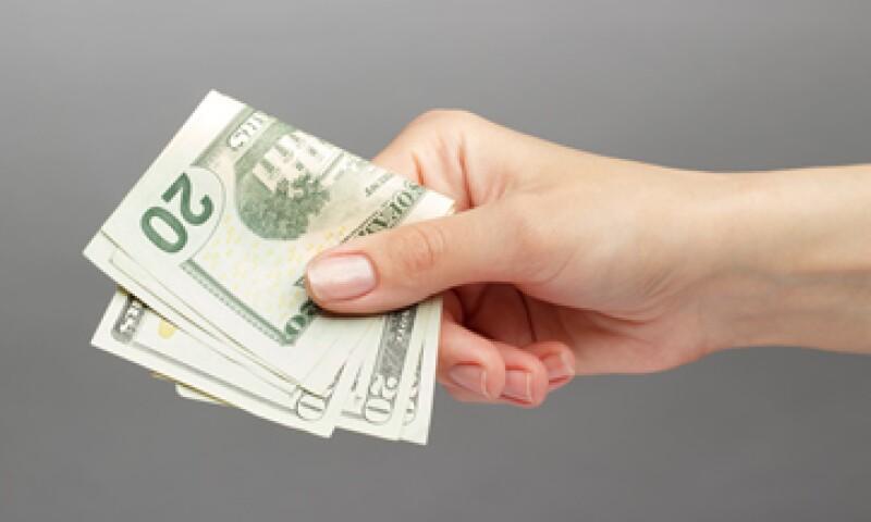 Cualquier ganancia del dólar el año próximo será menos impresionante que la de 2014, según el sondeo de Reuters (Foto: Shutterstock)