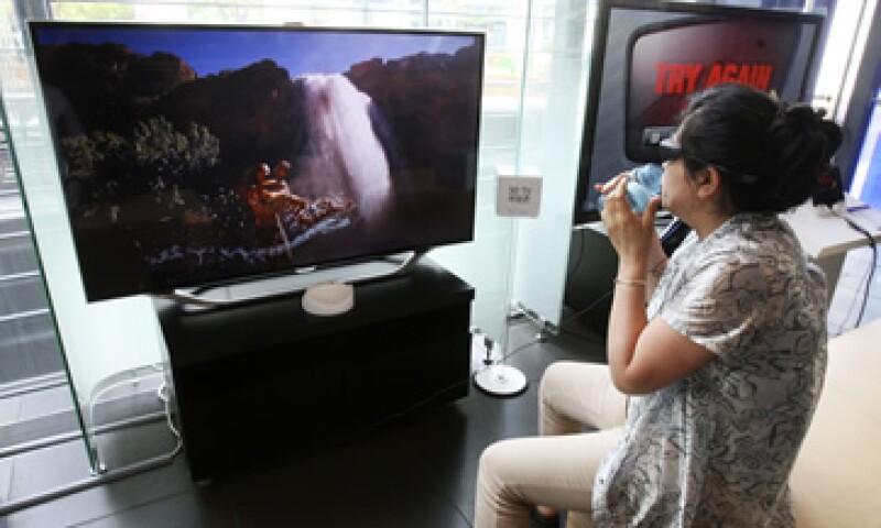 Samsung se ha asociado con otras compañías para incluir servicios de música o video en sus televisores. (Foto: AP)