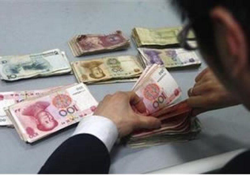 Expertos chinos sostienen que el yuan no es culpable del déficit estadounidense. (Foto: Reuters)