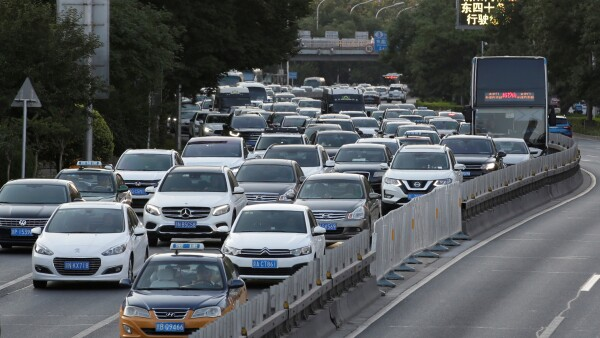Cars drive on the road during the evening rush hour in Beijing