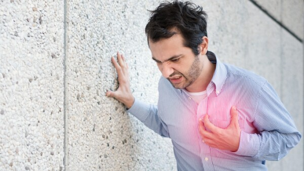 Man feeling a big pain on the chest and collapsing