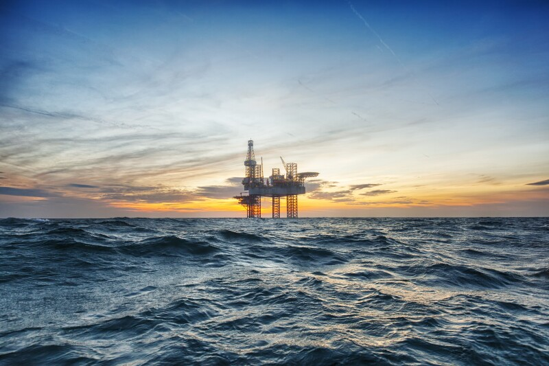 Offshore drilling rig at sunset