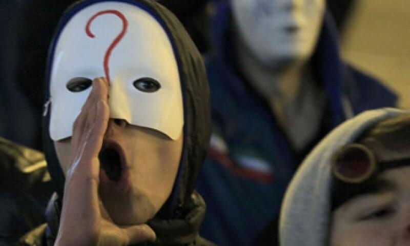 La Federación de Bancos de Brasil pide la aprobación de una ley que tipifica como delito los ataques y los fraudes cibernéticos, como el de Anonymous. (Foto: Reuters)