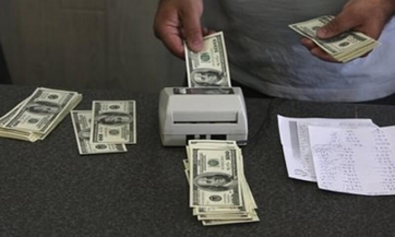 Estados Unidos captó un flujo neto de capitales de largo plazo de 30,600 mdd en abril desde 24,000 mdd. (Foto: AP)