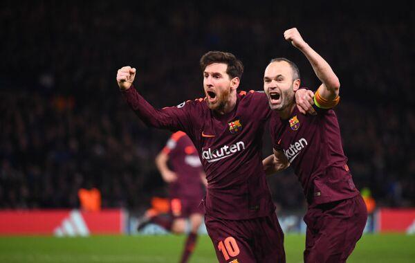Andrés Iniesta con Lionel Messi