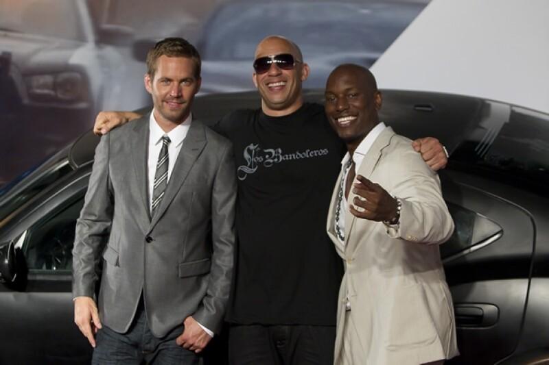 Paul con Vin Diesel y Tyrese Gibson en 2011.