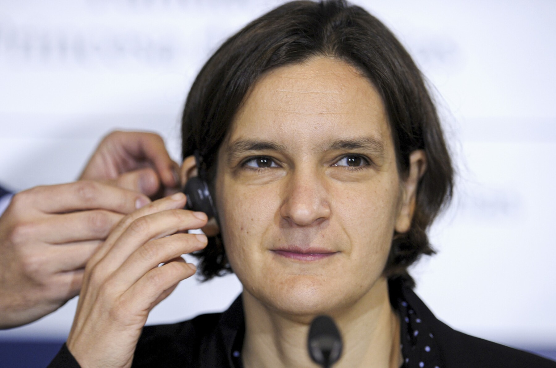 FILE PHOTO: French economist Esther Duflo gets fitted with an earphone before a news conference in Oviedo,