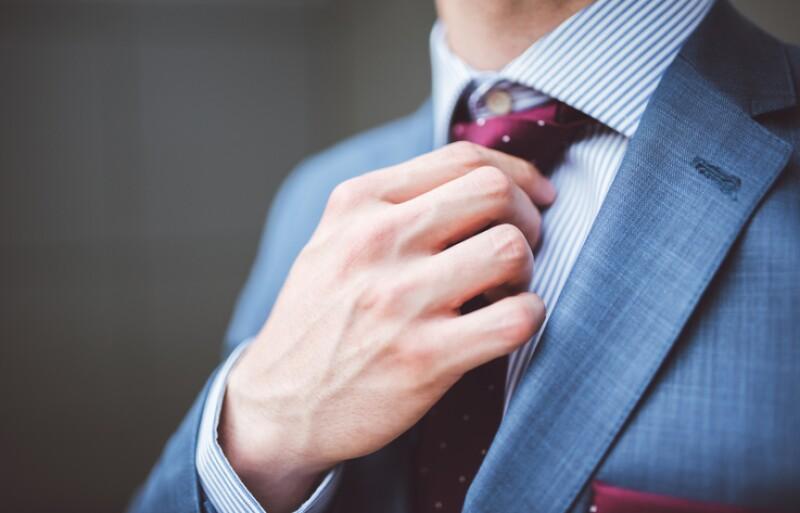 Businessman fixing his tie