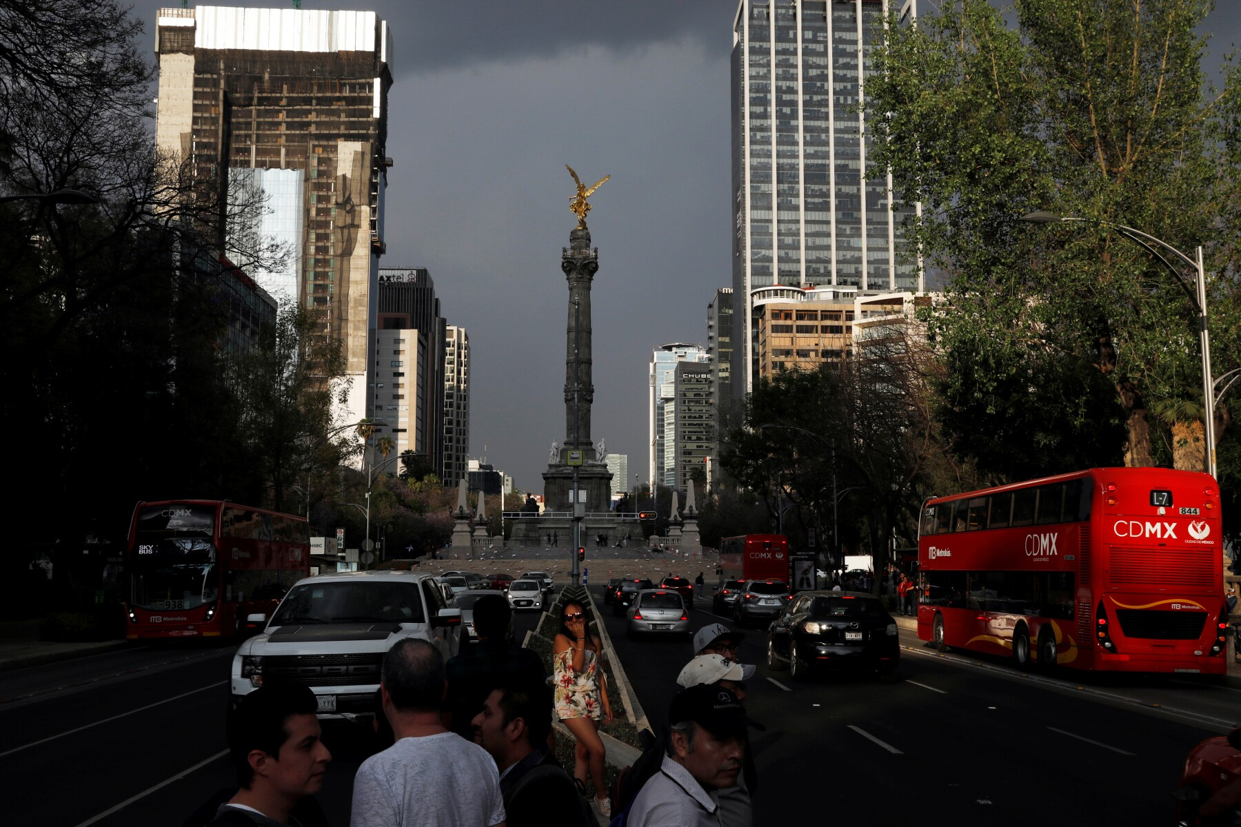 The Angel of Independence monument is seen as British double-decker buses, which are part of a one billion peso deal with Britain to help the sprawling capital tackle traffic and pollution, moves through Mexico City, Mexico