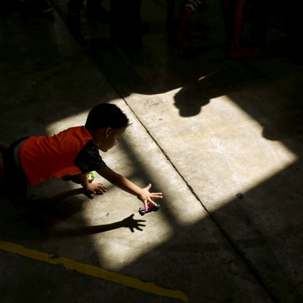 A migrant boy, who returned to Mexico with his parents from the U.S. under the Migrant Protection Protocols, plays at a migrant shelter run by the federal government in Ciudad Juarez